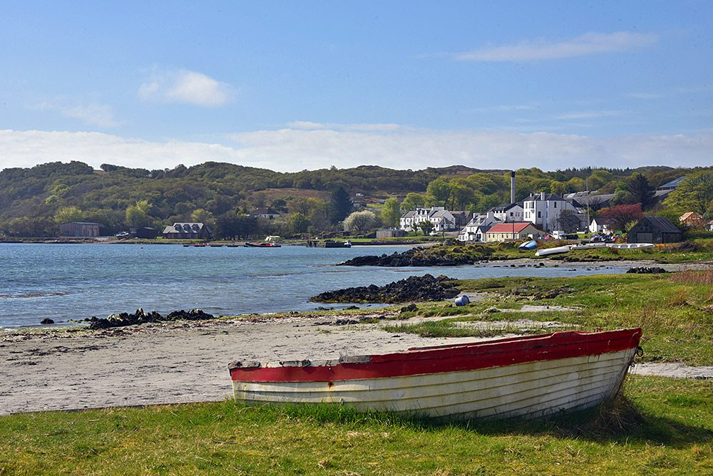 Picture of a coastal village, an old rowing boat in the foreground
