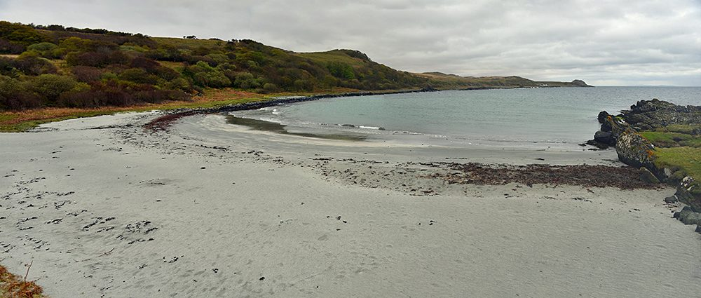 Panoramic picture of a small beach under a cloudy sky