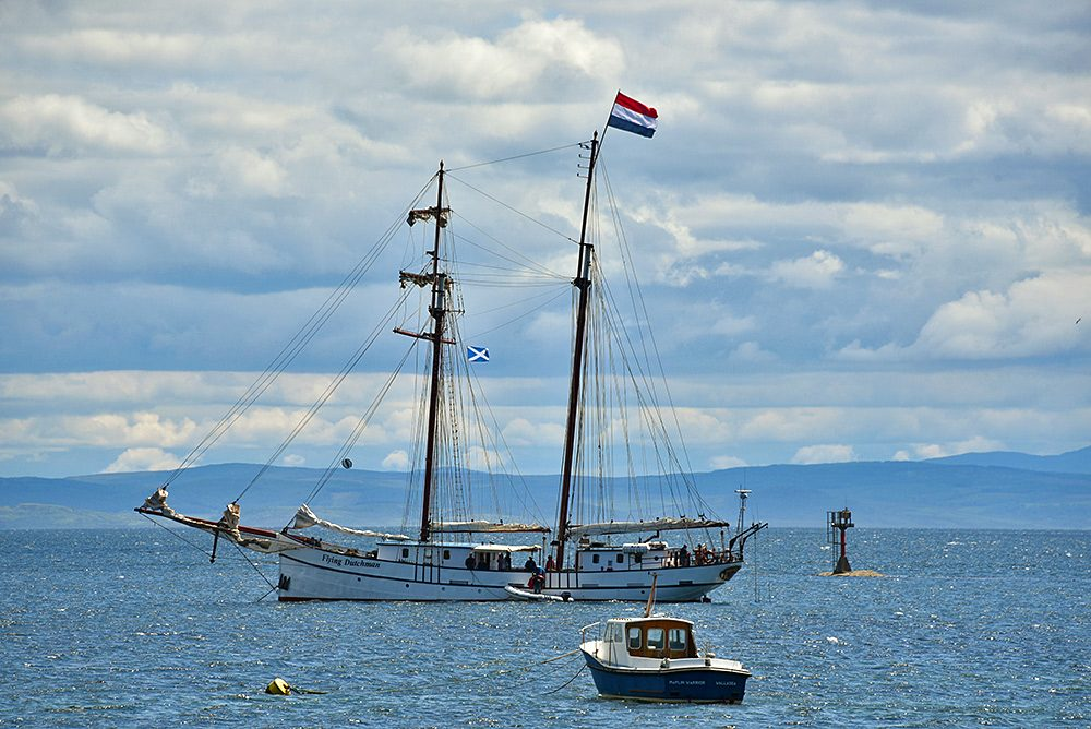 Picture of the sailing schooner Flying Dutchman anchored in a bay