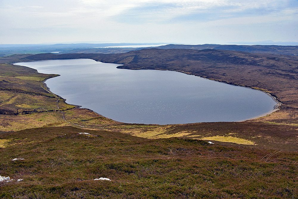 Picture of a freshwater loch with a sea loch in the distance