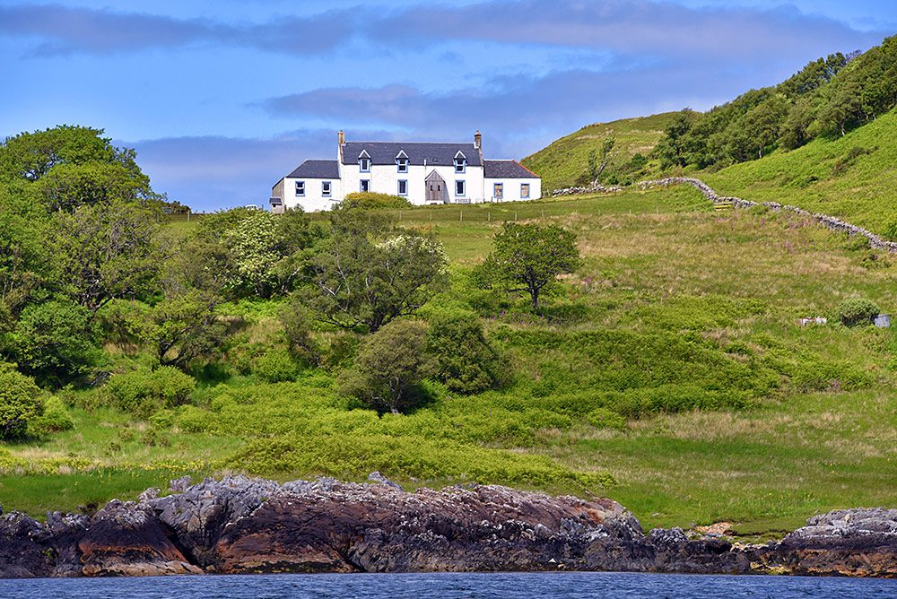 Picture of Barnhill on Jura where George Orwell wrote 1984 seen from the water