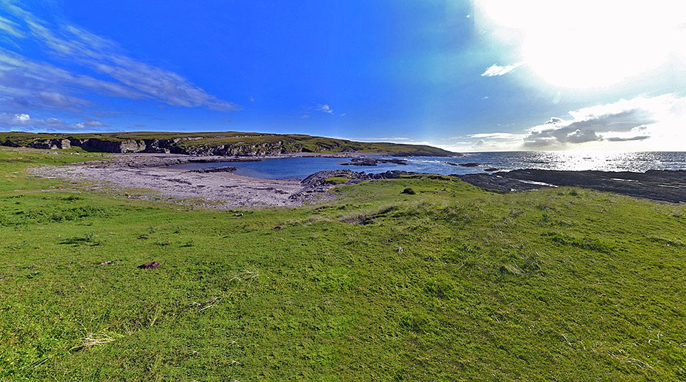 Panoramic picture of a small bay on a west facing coast