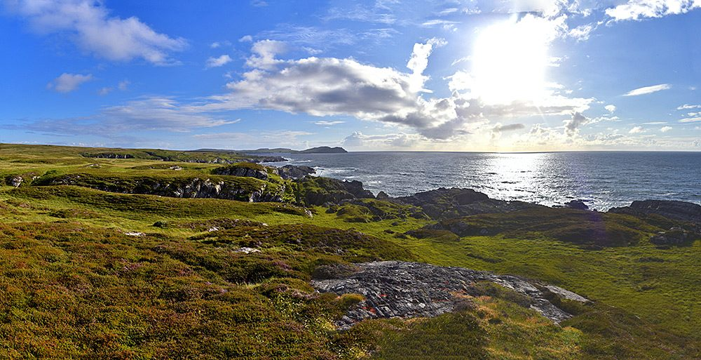 Panoramic picture of a rugged coastal landscape on June summer evening