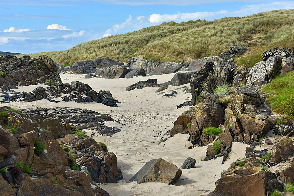 Picture of rocks, sands and dunes at a coast