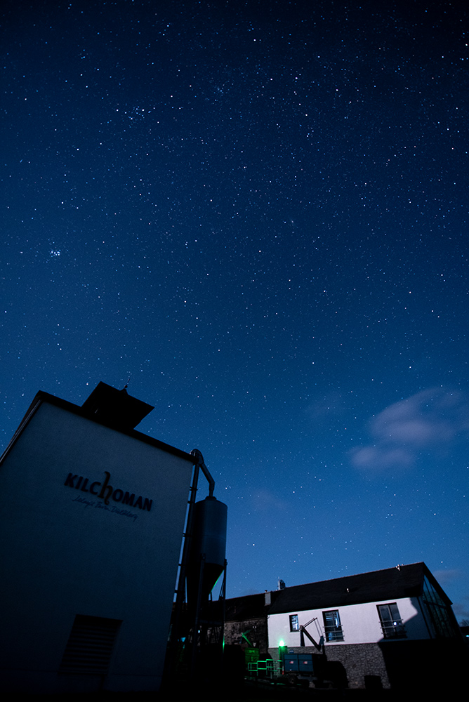 Picture of a starry night sky over a small farm distillery