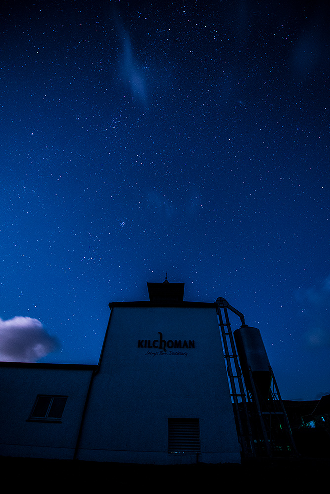 Picture of a starry night sky over a small farm distillery maltings (Kilchoman distillery)
