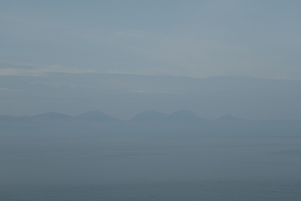 Picture of distant mountains seen on a hazy day from a ferry