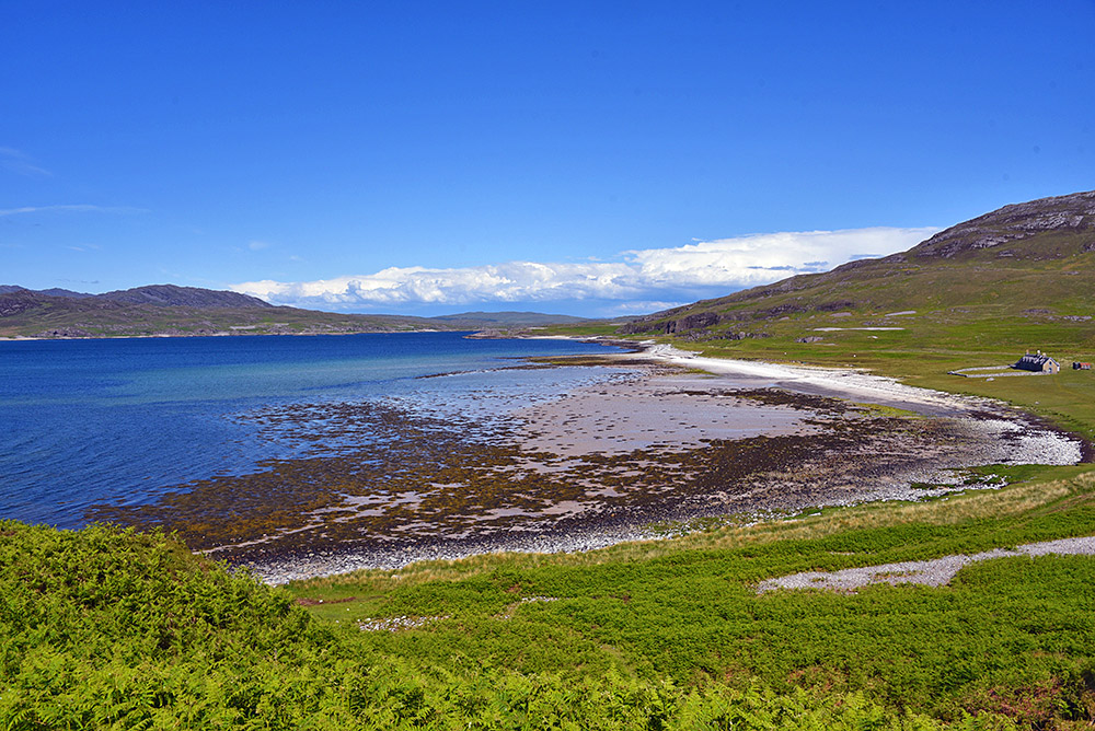 Picture of a sea loch with a large lodge on the shore