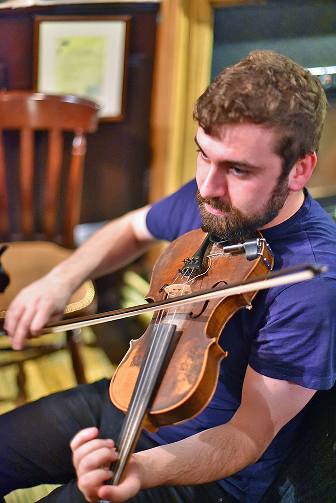 Picture of Jamie MacDonald playing the fiddle at the Islay Sessions 2019