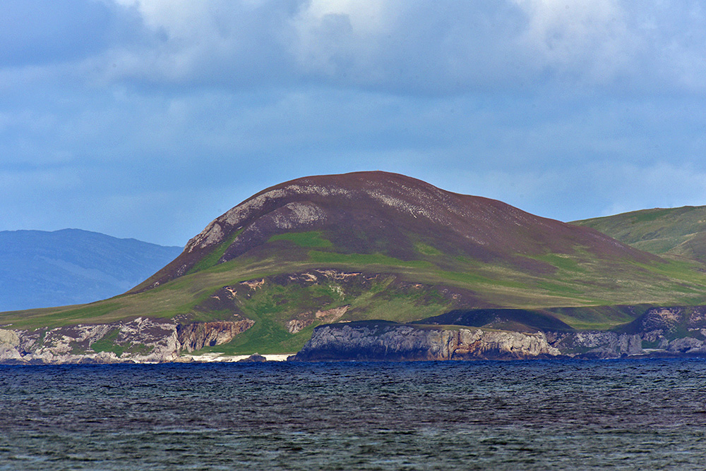 Picture of a small hill seen across the sea