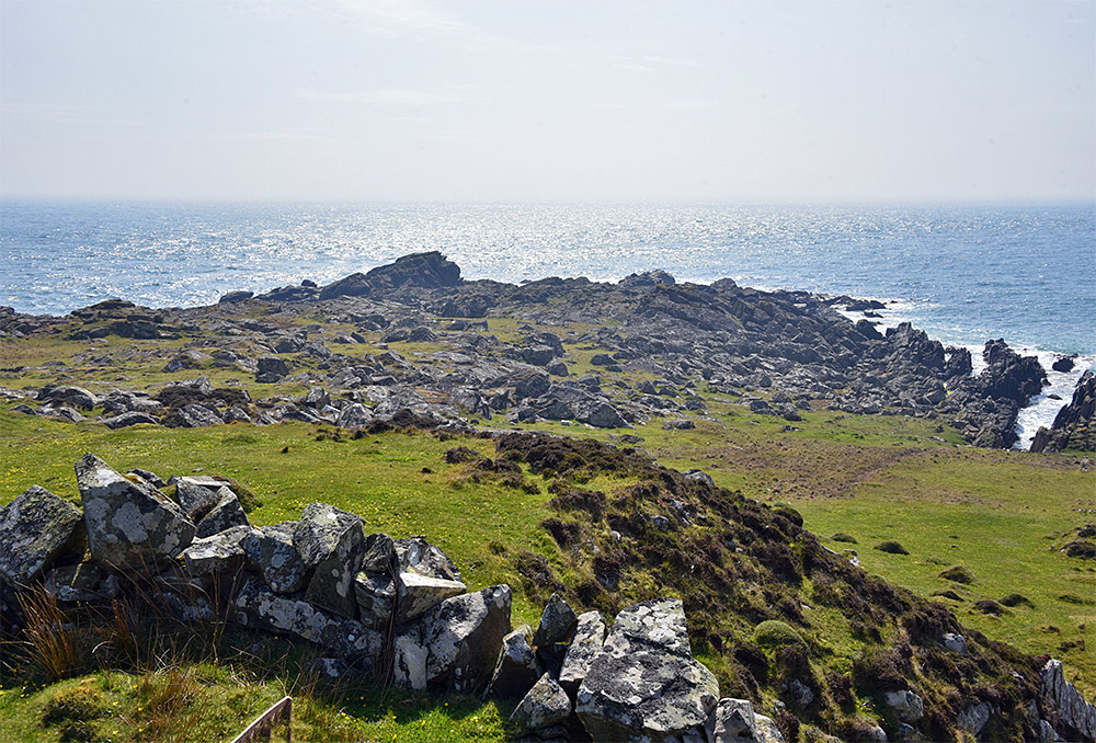 Picture of a small coastal rocky outcrop, the most southerly point on the Isle of Islay