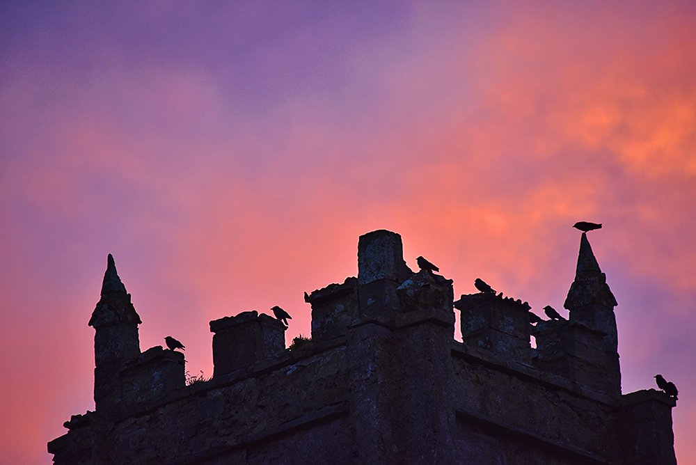 Picture of the top of an old church tower at sunset