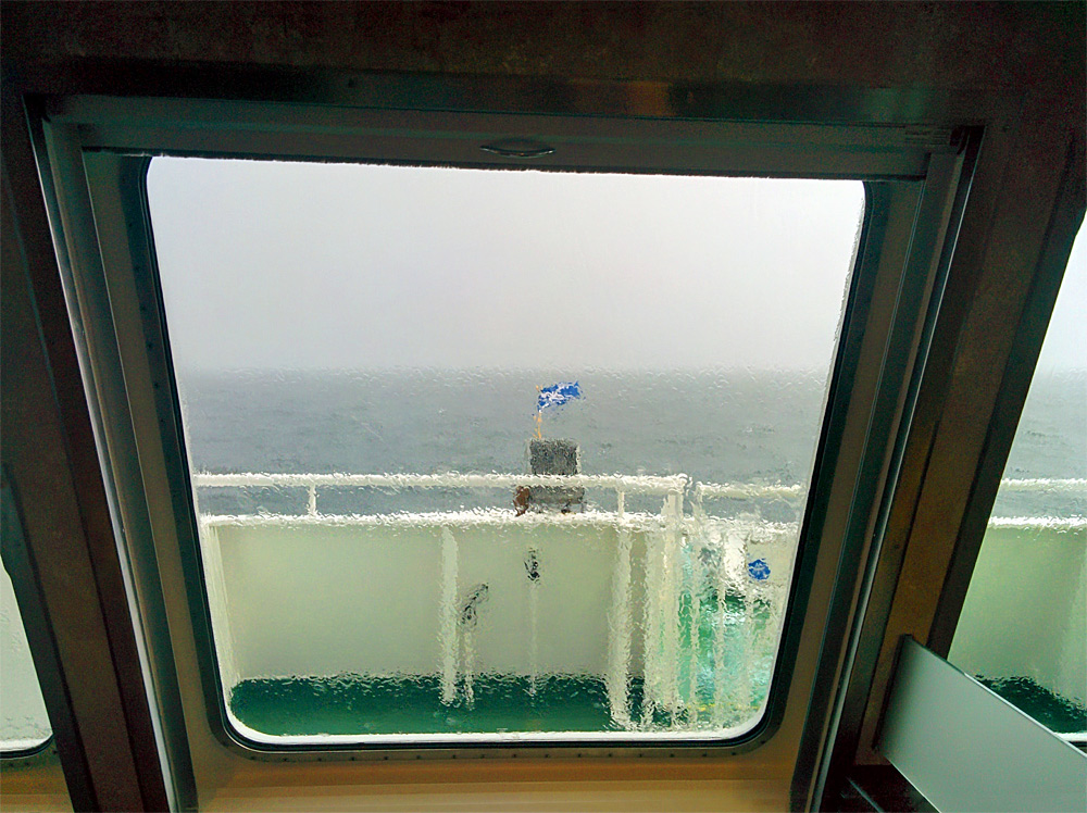 Picture of a wet ferry window in the rain
