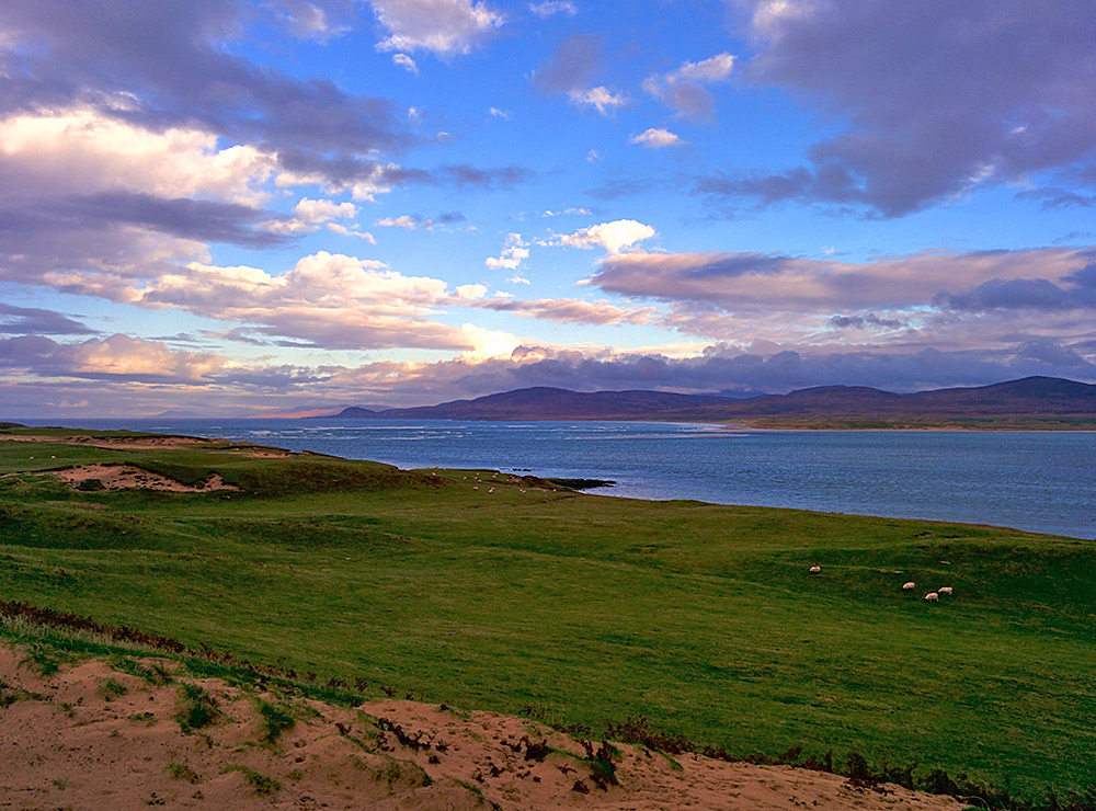 Picture of a view over the mouth of a sea loch on a partially cloudy November afternoon