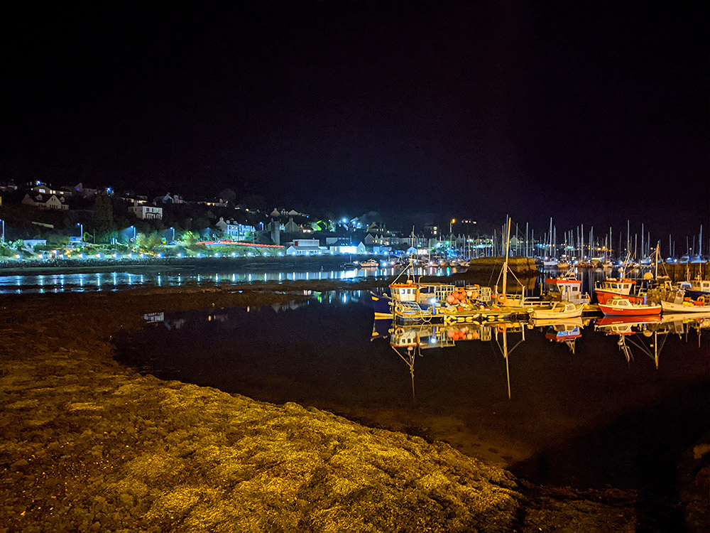 Picture of a small fishing town harbour at night