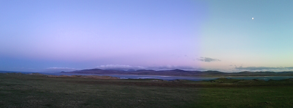 Panoramic picture of a view over a sea loch on a November late afternoon after sunset