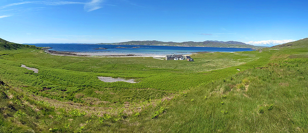 Panoramic picture of a lodge on the shore of a sea loch