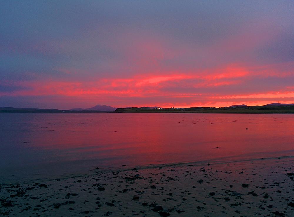 Picture of a November dawn over a coastal village at a sea loch