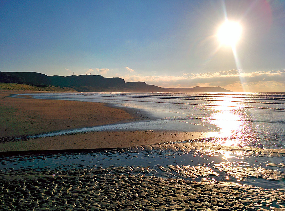 Picture of a sandy beach bathed in beautiful November sunshine