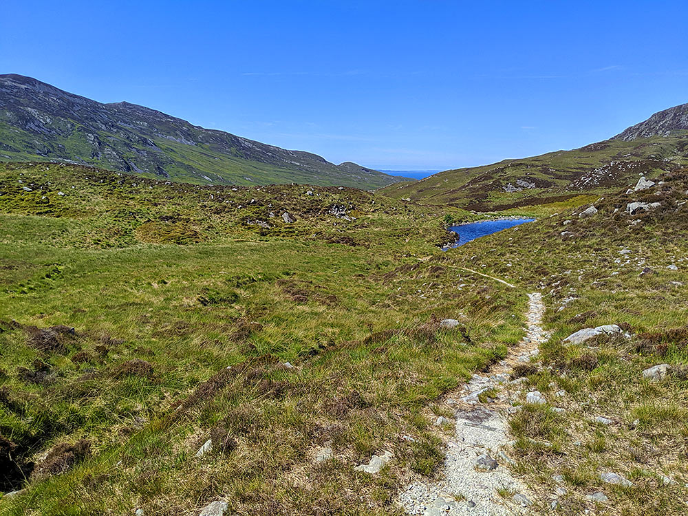 Picture of narrow walking path across a wide open landscape