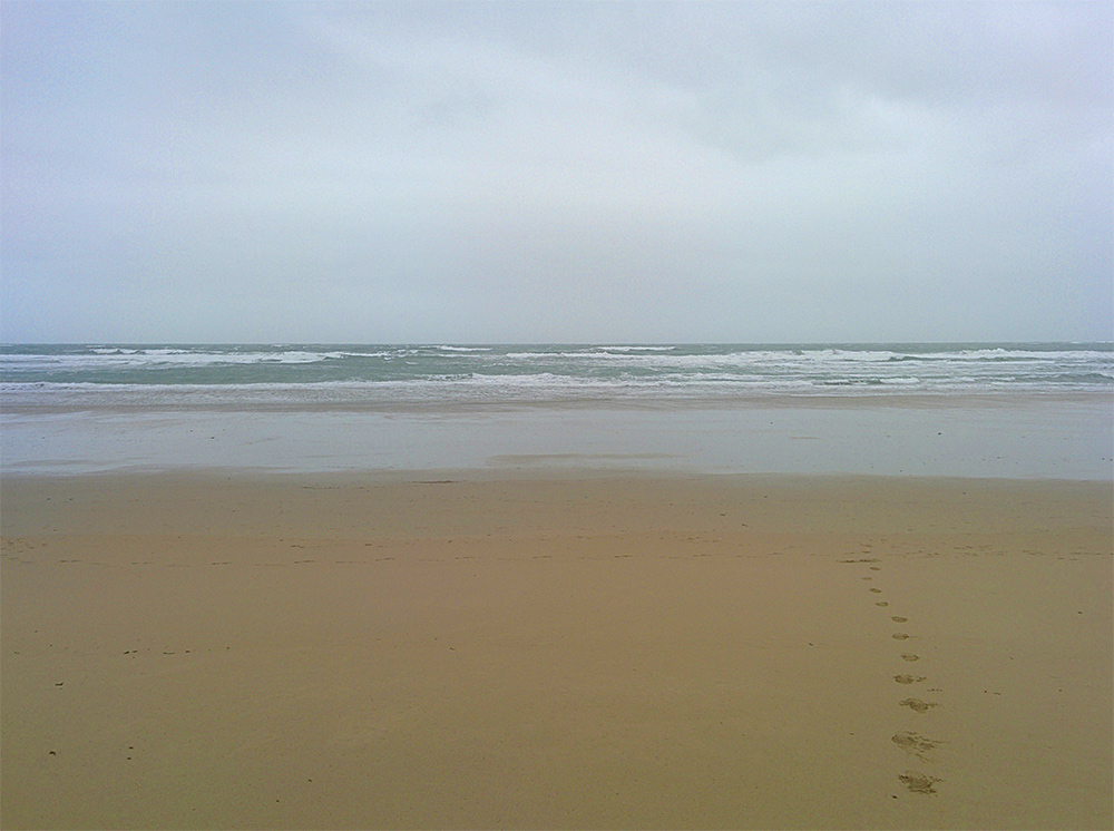 Picture of a sandy beach on a grey overcast day