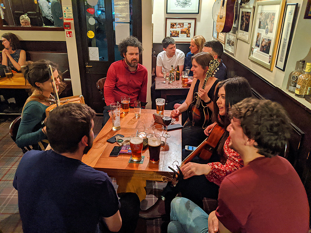 Picture of musicians around a table in a pub