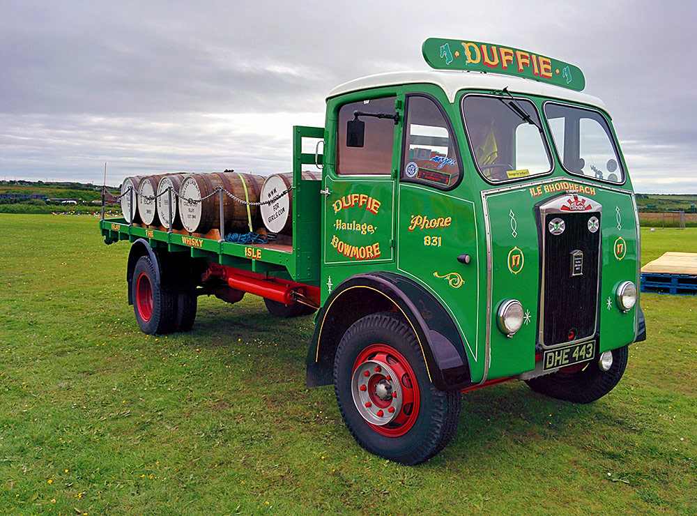 Picture of an old restored flatbed lorry with whisky casks