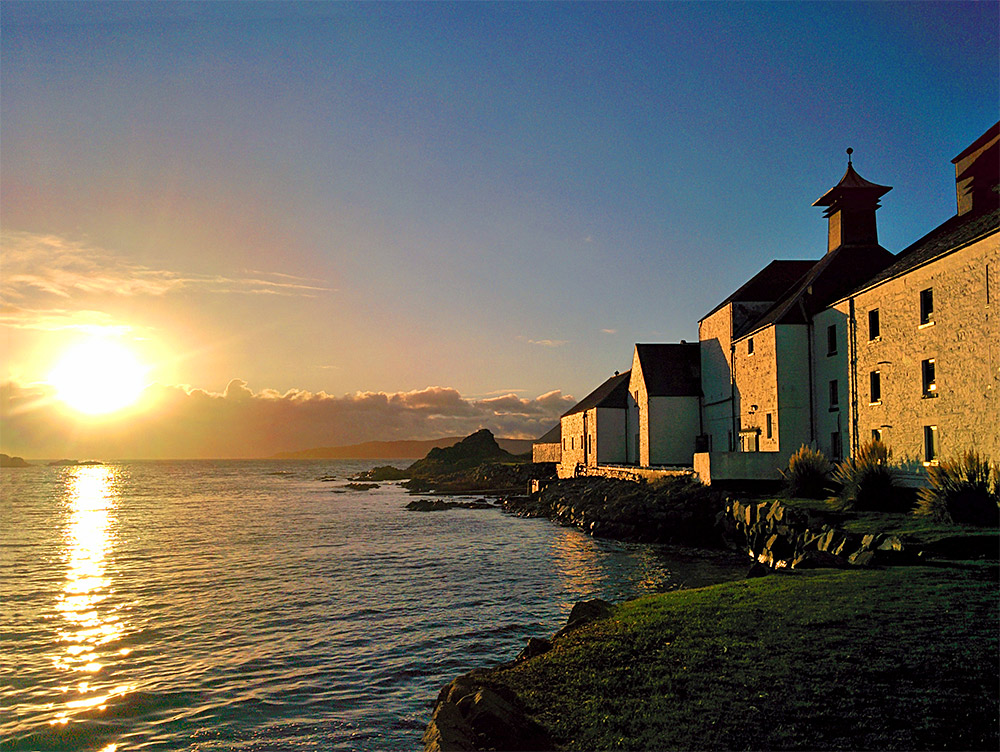 Picture of a coastal distillery (Laphroaig on Islay) in the low November afternoon sun
