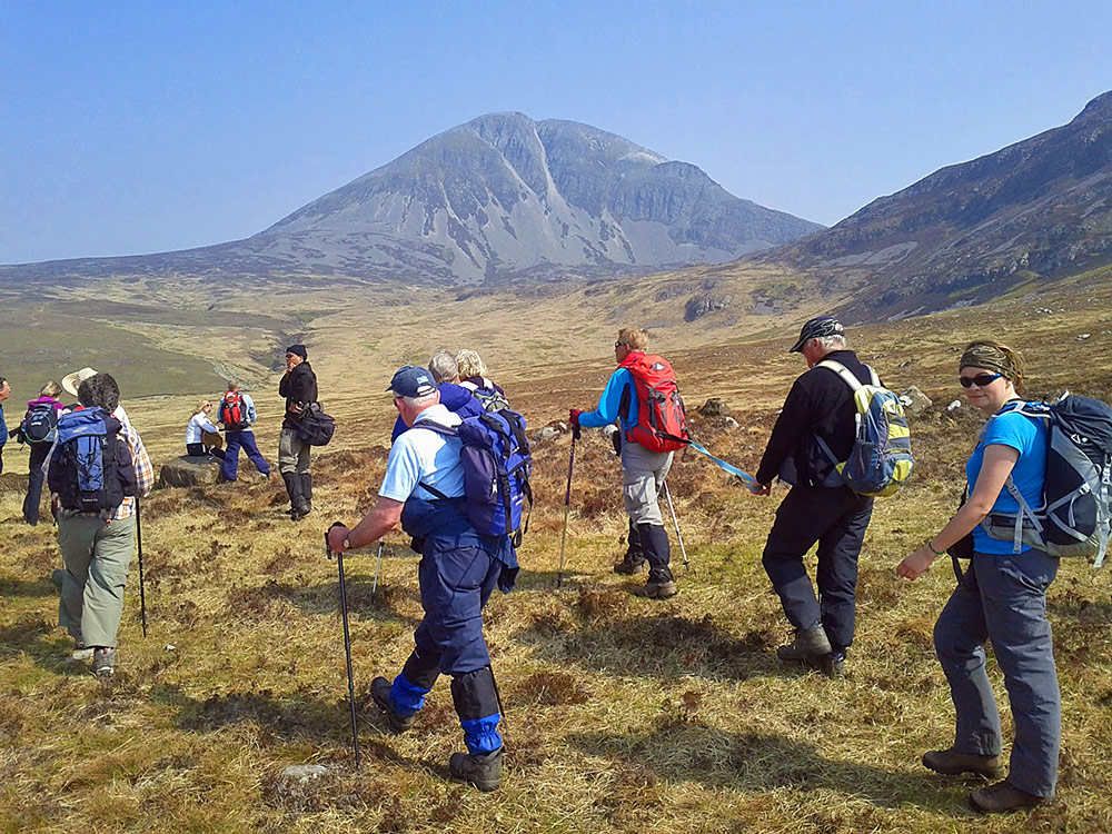 Picture of a group of walkers at the foot of some mountains