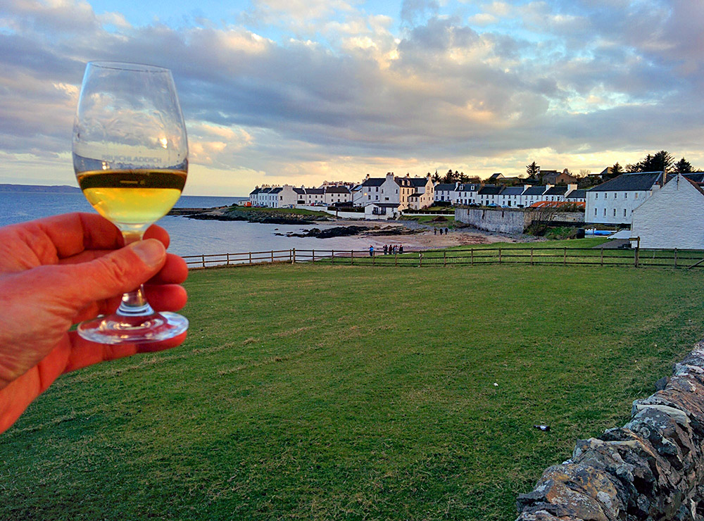 Picture of a wee dram of Port Charlotte Islay single malt whisky outside the village of Port Charlotte on Islay