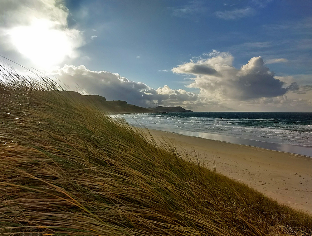 Picture of dunes, a beach and a bay in some dramatic November light