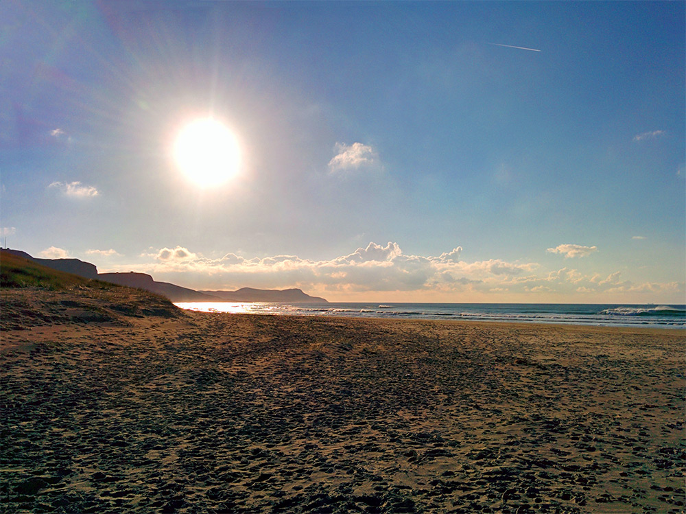 Picture of a golden sandy beach in mild November sunshine