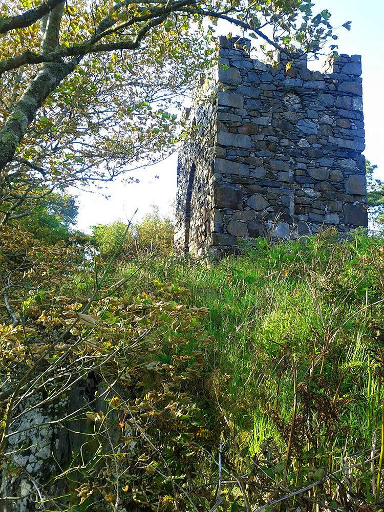 Picture of an old stone tower on a small hill