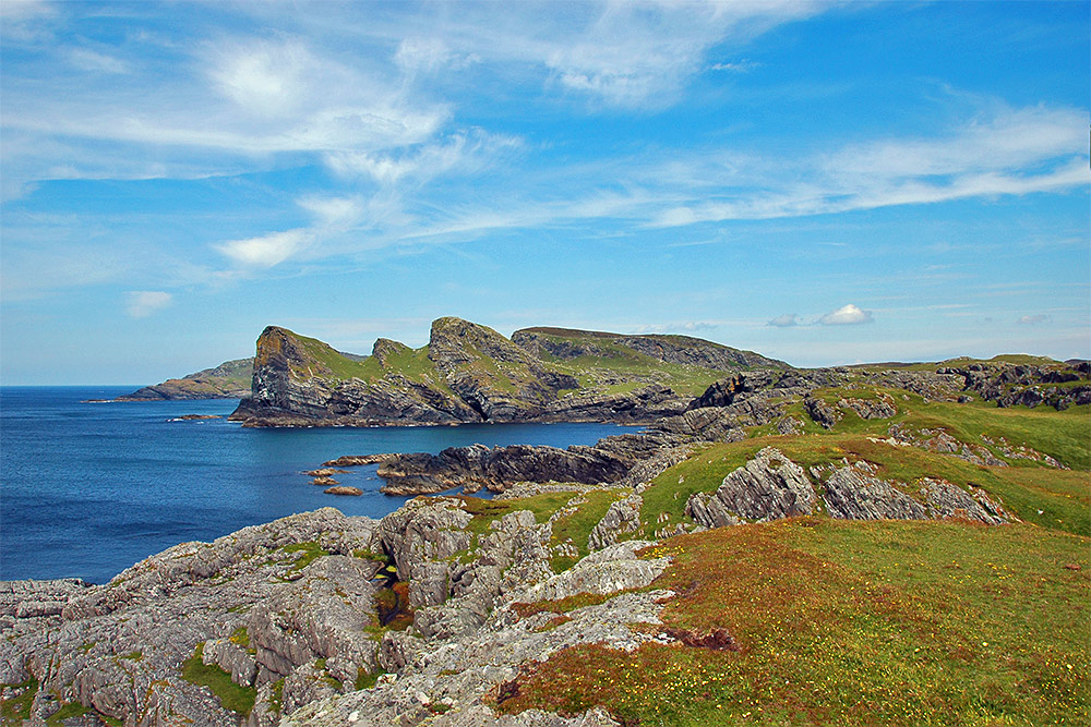 Picture of a variety of cliffs along a rugged coastline