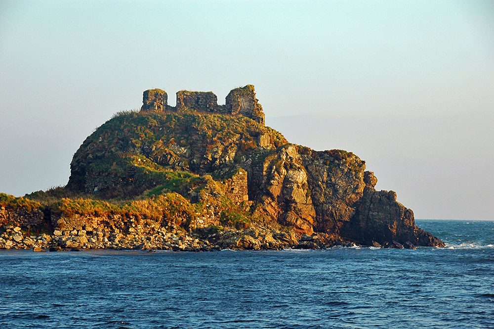 Picture of the ruin of an old castle at a coast in the October afternoon sun
