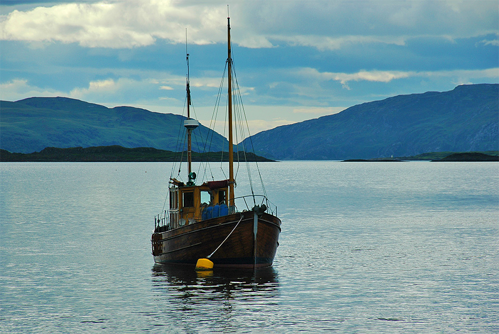 Picture of an old wooden boat moored off a Scottish coast