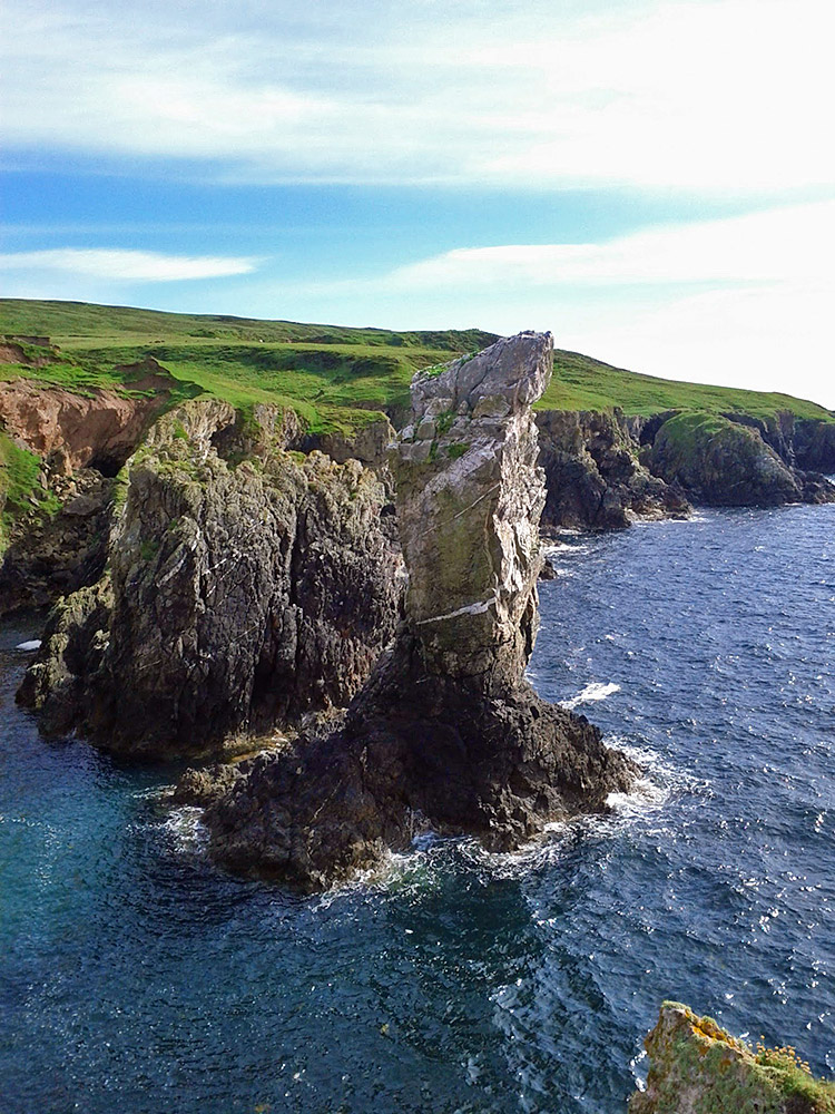 Picture of a sea stack in front of cliffs