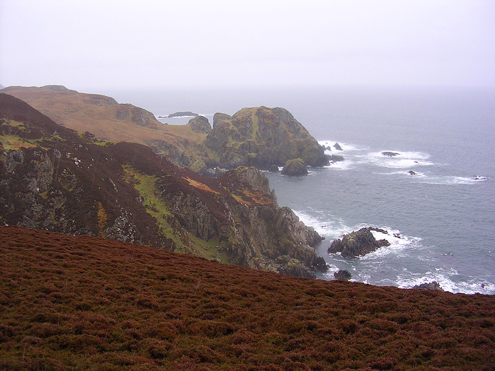 Picture of some steep and dramatic cliffs on a rainy day