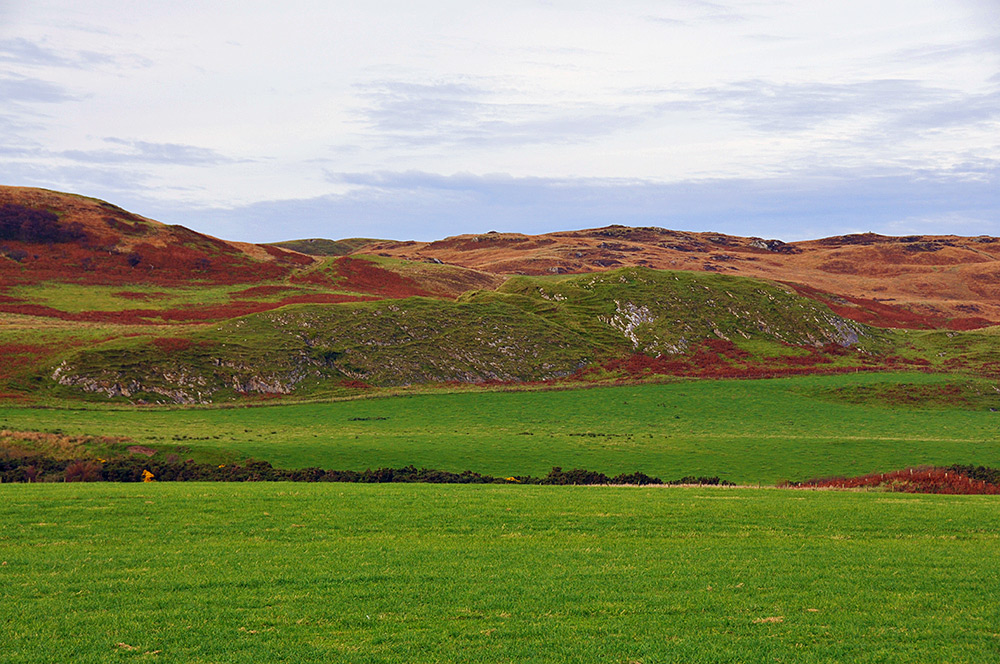 Picture of the remains of an Iron Age hill fort, seen from a distance