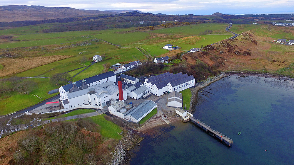 Aerial picture of a coastal distillery, Lagavulin on Islay