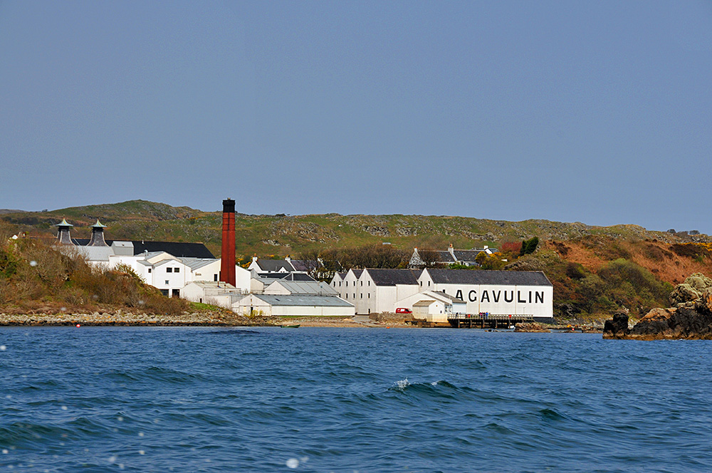 Picture of Lagavulin distillery from a boat leaving Lagavulin Bay