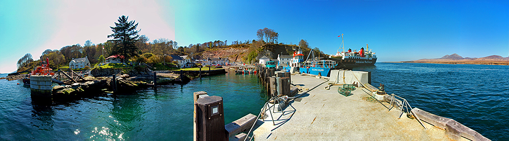 Panoramic picture of a small ferry port from an adjacent fishing pier