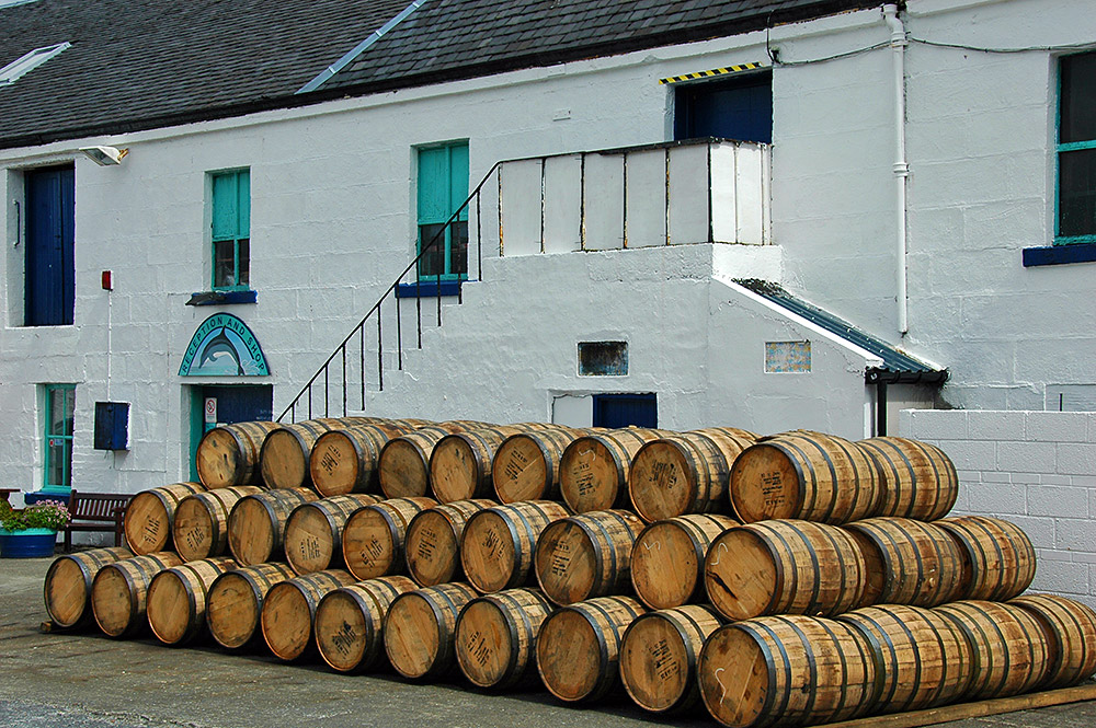 Picture of a pile of casks in a distillery courtyard