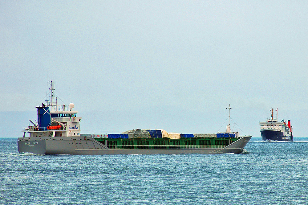 Picture of a ship called Scot Isles passing a ship called Hebridean Isles