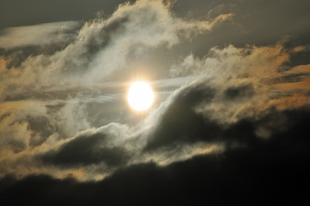 Picture of the sun breaking through some dramatic clouds