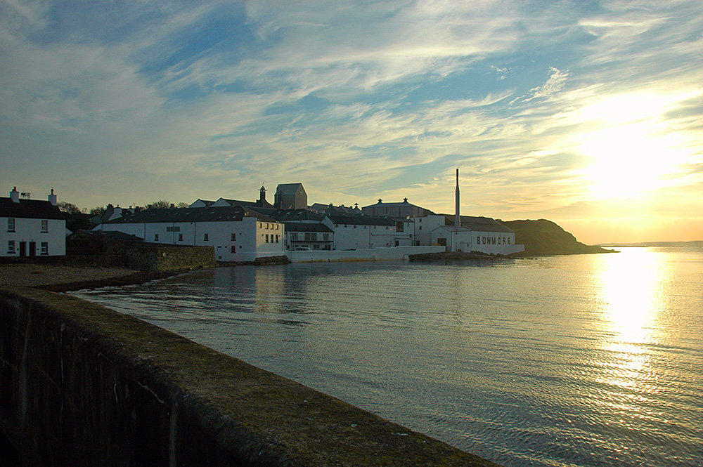 Picture of a coastal distillery (Bowmore on Islay) at an approaching October sunset