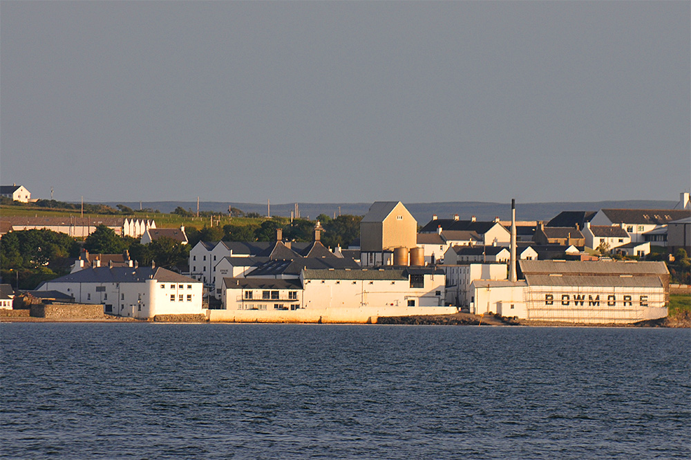 Picture of Bowmore distillery seen across Loch Indaal in the mild June evening light
