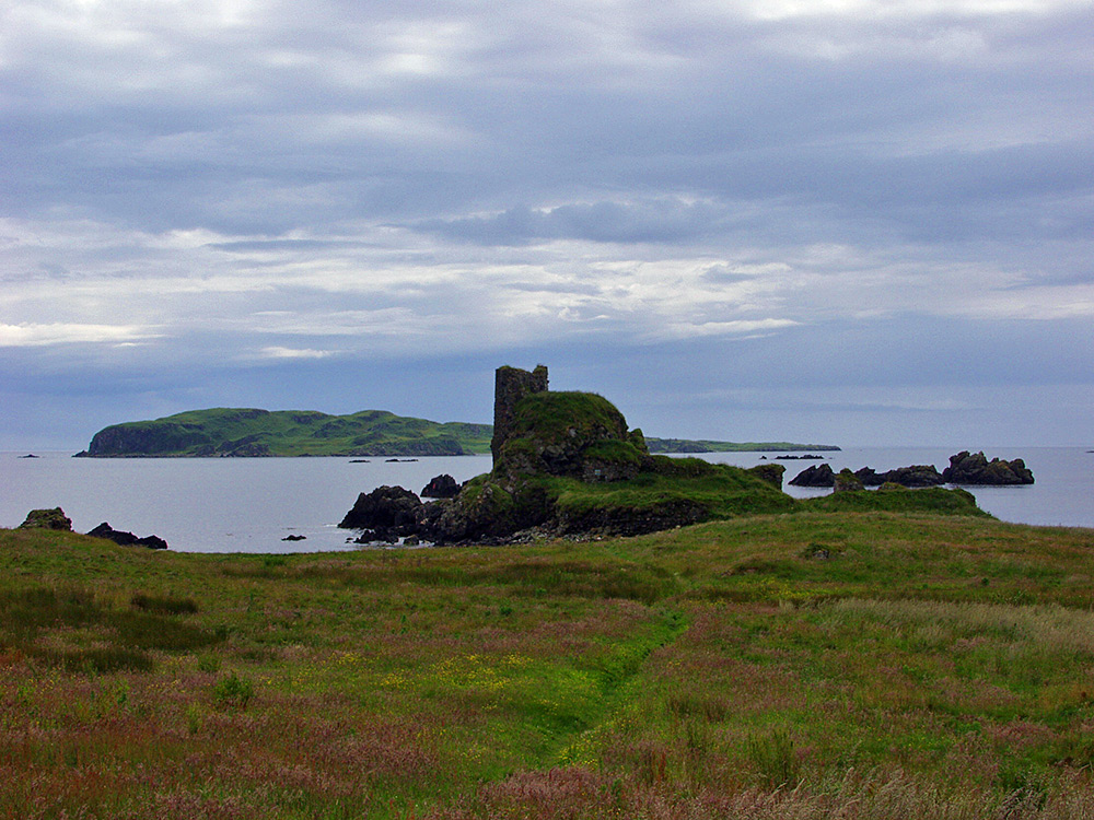 Picture of the ruin of an old castle on a shore with a smaller island behind
