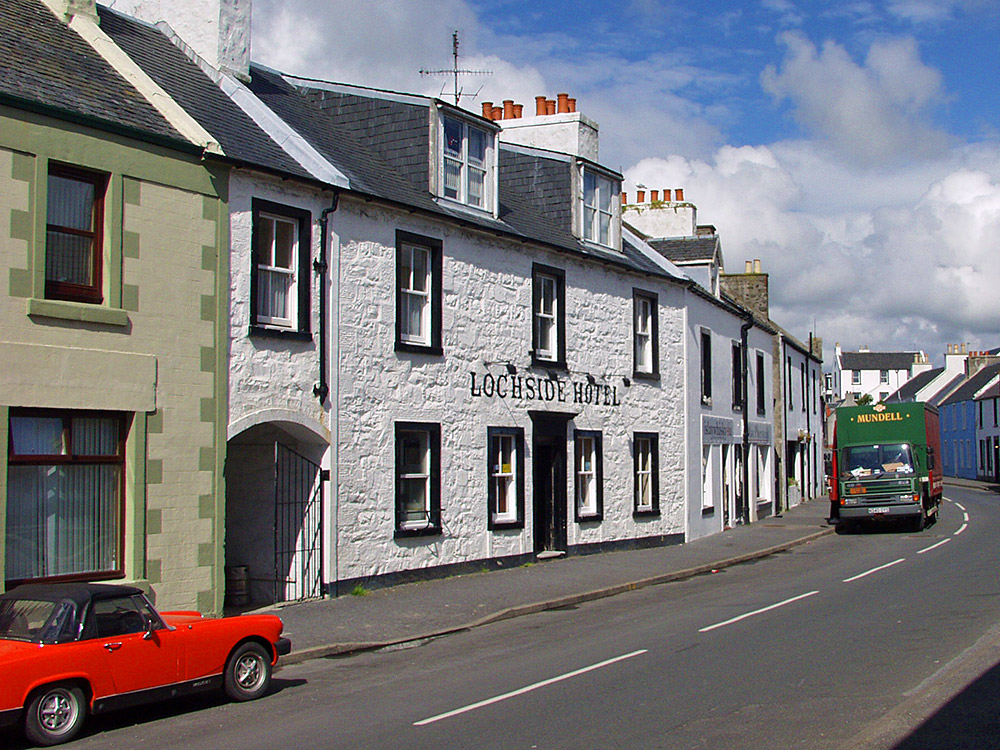 Picture of the Lochside Hotel on Islay with a Mundell lorry parked on the road