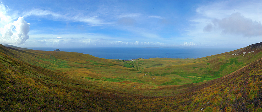 Panoramic picture of a view from hills over a northern coastline
